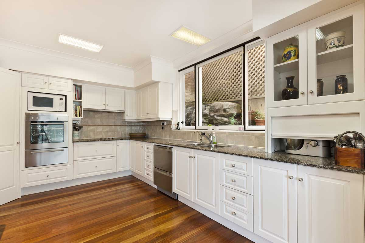 White Grooved Door Style L Shape Modular Kitchen
